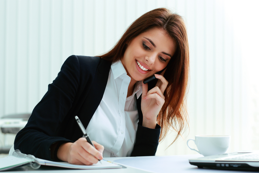 PRT Staffing Steps to Asking for a Perfect Job Reference Smiling Businesswoman on the Phone Taking Notes