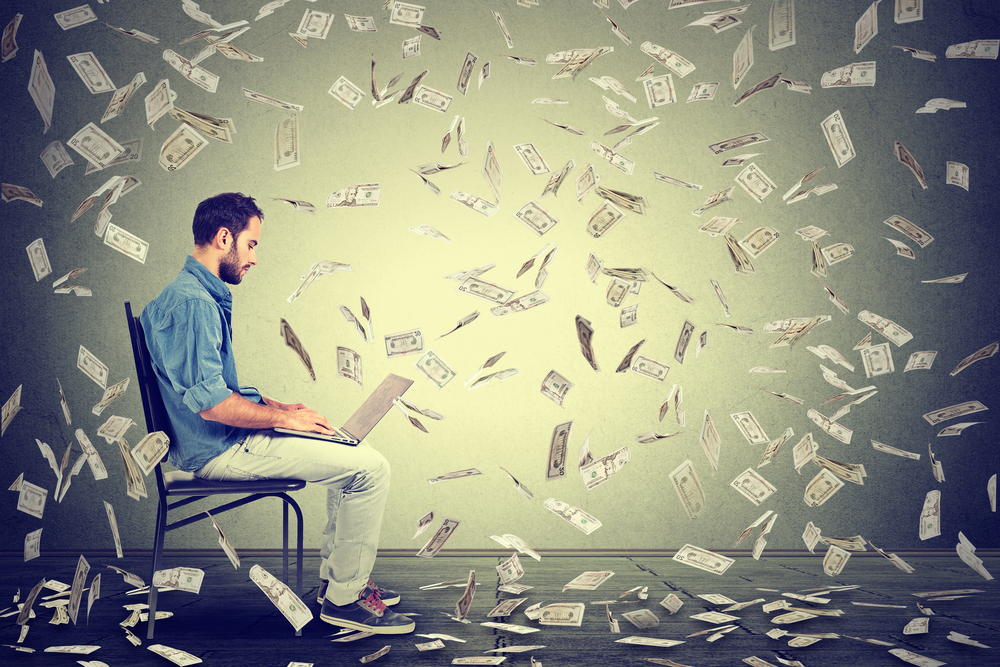 PRT Staffing Avoiding the Costly Mistake of Making a Bad Hire Man in Chair with Computer and Money Swirling