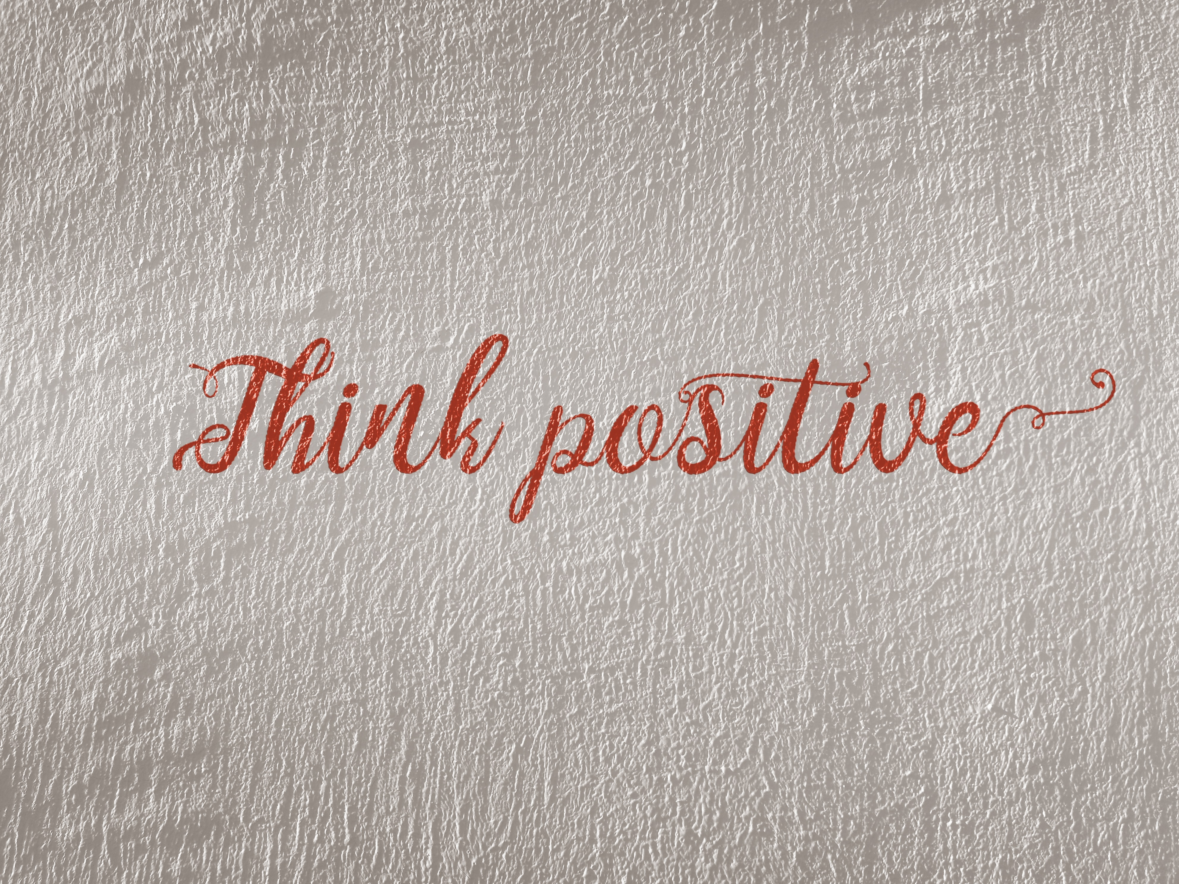 PRT Staffing Work Culture Promoting Positivity Think Positive Script on White Wall